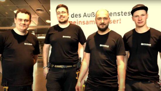 Vier Mitarbeiter von Eventnet auf einer Veranstaltung